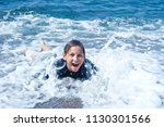 happy boy covered with foam... | Shutterstock . vector #1130301566