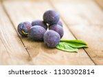 organic plums on rustic... | Shutterstock . vector #1130302814