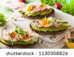 open sandwiches with avocado...   Shutterstock . vector #1130308826