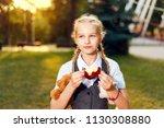 schoolgirl with pigtails in... | Shutterstock . vector #1130308880