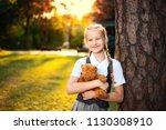 portrait of happy schoolgirl... | Shutterstock . vector #1130308910