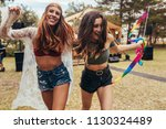 hipster girls having fun at... | Shutterstock . vector #1130324489
