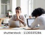 upset millennial workers...   Shutterstock . vector #1130335286