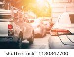 back of car on urban street... | Shutterstock . vector #1130347700