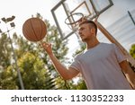 young street basketball player... | Shutterstock . vector #1130352233