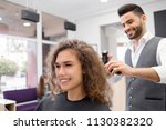 young haircutter doing... | Shutterstock . vector #1130382320
