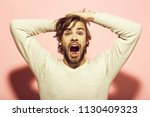 scared man. surprised man with... | Shutterstock . vector #1130409323