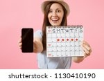 woman holding female periods... | Shutterstock . vector #1130410190