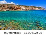beautiful beach with clear... | Shutterstock . vector #1130412503