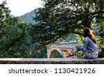 the girl in denim clothes... | Shutterstock . vector #1130421926