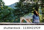 the girl in denim clothes... | Shutterstock . vector #1130421929