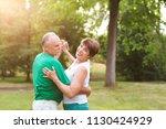 senior couple dancing in park... | Shutterstock . vector #1130424929