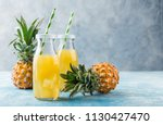 pineapple cocktail or juice in... | Shutterstock . vector #1130427470