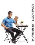 young man sitting at a coffee... | Shutterstock . vector #1130459306
