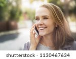 a lovely young blonde girl... | Shutterstock . vector #1130467634