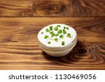 sour cream with green onion in...   Shutterstock . vector #1130469056