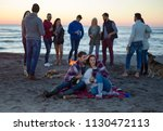 Young Couple Sitting Friends Around - Fine Art prints