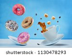 flying cup of coffee with... | Shutterstock . vector #1130478293