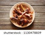 leftovers and bones in plate on ...   Shutterstock . vector #1130478839