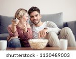 young couple relaxing in their... | Shutterstock . vector #1130489003