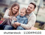 happy family.father mother and... | Shutterstock . vector #1130494103