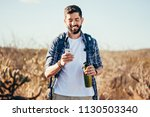 hiker using mobile phone during ...   Shutterstock . vector #1130503340