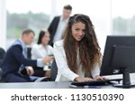 manager woman sitting behind a... | Shutterstock . vector #1130510390