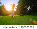 blurred golfer playing golf in... | Shutterstock . vector #1130529326