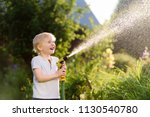 funny little boy playing with... | Shutterstock . vector #1130540780