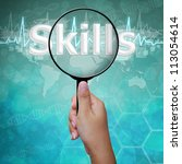 Skills , word in Magnifying glass on medical background  - stock photo