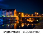 houses by the river in the city ... | Shutterstock . vector #1130586980