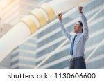 asian male business man raising ... | Shutterstock . vector #1130606600