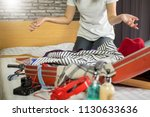 woman trying to fit all... | Shutterstock . vector #1130633636