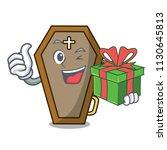 with gift coffin mascot cartoon ... | Shutterstock .eps vector #1130645813