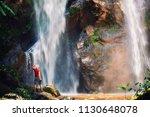 happy man backpacker enjoying... | Shutterstock . vector #1130648078