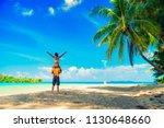 young happy couple on seashore | Shutterstock . vector #1130648660