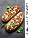 caprese bruschetta toasts with... | Shutterstock . vector #1130661059