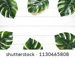 green leaf on white wood... | Shutterstock . vector #1130665808