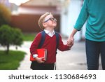 parent taking child to school.... | Shutterstock . vector #1130684693