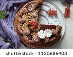 big festive cut chocolate cake... | Shutterstock . vector #1130686403