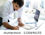business man working with... | Shutterstock . vector #1130696153