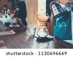 barista pouring hot water into... | Shutterstock . vector #1130696669
