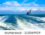 cargo ship sailing in to the... | Shutterstock . vector #113069929