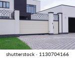 automatic white gate with... | Shutterstock . vector #1130704166