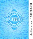 carefree light blue emblem with ... | Shutterstock .eps vector #1130704400