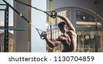 sportsman  athlete  muscular... | Shutterstock . vector #1130704859