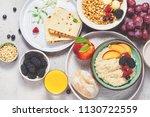 breakfast. oatmeal with berries ... | Shutterstock . vector #1130722559