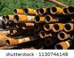 oil drill pipe. rusty drill... | Shutterstock . vector #1130746148