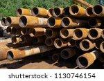 oil drill pipe. rusty drill... | Shutterstock . vector #1130746154