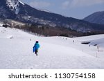 a child playing a sled at a ski ... | Shutterstock . vector #1130754158